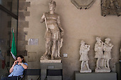 Attendant and sculptures in the Bargello Gallery, Florency, Italy