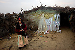 A Bedouin girl in the desert in the Sinai peninsula, not far from the border with Israel, Jan. 28, 2010. Some Bedouin make a living smuggling goods and humans from Egypt across the Gaza and Israel borders. A barrier wall being built buy Egypt may impact the illegal trade, causing strife between the government and Egypt's marginalized Bedouin tribes.