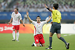 19 August 2008: Kevin Mirallas (BEL) (9) appeals to referee Pablo Pozo (CHI).  The men's Olympic soccer team of Nigeria defeated the men's Olympic soccer team of Belgium 4-1 at Shanghai Stadium in Shanghai, China in a Semifinal match in the Men's Olympic Football competition.