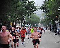 The Capitol is shrouded in fog at the beginning of the Madison Mini-Marathon on Saturday, 8/21/10, in Madison, Wisconsin