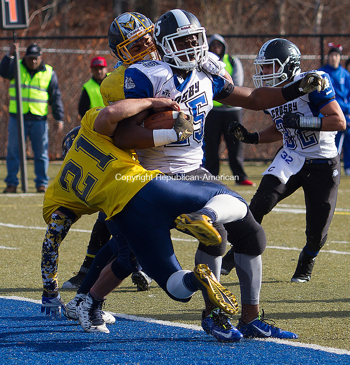 WATERURY, CT - 26 NOVEMBER 2015 -112615JW03.jpg -- Crosby #25 Mc Henry fights his way into the endzone past Kennedy #21 Bryan Garcia-Medina and #1 Jaedon Wolfe during the Thanksgiving Day 2015 Brass Division and City Championship game at Ray Snyder Sr. Field Thursday morning. Crosby won 18-15.  Jonathan Wilcox Republican-American