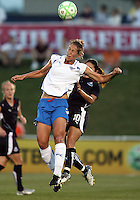 Homare Sawa #10 of the Washington Freedom loses out on a header to Maggie Tomecks#5 of the Boston Breakers during a WPS match at Maryland Soccerplex on July 29, in Boyds, Maryland. Freedom won 1-0.