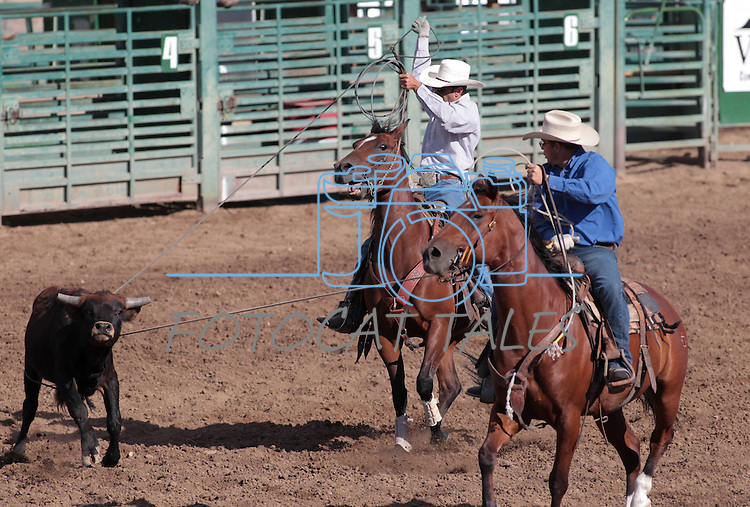 The Sweetwater Ranch team competes in the team roping event at the Minden Ranch Rodeo on Saturday, July 21, 2012..Photo by Cathleen Allison