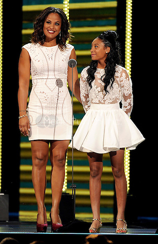 LAS VEGAS, NV: Laila Ali (L) and Mo'ne Davis speak onstage at the 2014 Soul Train Music Awards at the Orleans Arena on November 7, 2014 in Las Vegas, Nevada. FMPG/MediaPunch