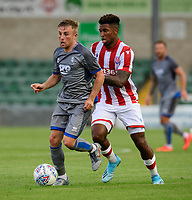 Lincoln City's Joe Morrell under pressure from Stoke City's Tyrese Campbell<br /> <br /> Photographer Chris Vaughan/CameraSport<br /> <br /> Football Pre-Season Friendly - Lincoln City v Stoke City - Wednesday July 24th 2019 - Sincil Bank - Lincoln<br /> <br /> World Copyright © 2019 CameraSport. All rights reserved. 43 Linden Ave. Countesthorpe. Leicester. England. LE8 5PG - Tel: +44 (0) 116 277 4147 - admin@camerasport.com - www.camerasport.com