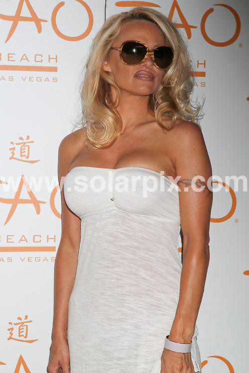 **ALL ROUND PICTURES FROM SOLARPIX.COM**.**SYNDICATION RIGHTS FOR UK, AUSTRALIA, DENMARK, PORTUGAL, S. AFRICA, SPAIN & DUBAI (U.A.E) & ASIA (EXCLUDING JAPAN) ONLY**.Pamela Anderson Celebrates Her Birthday at Tao Beach in Las Vegas, NV, USA, 10 July 2010.This pic: Pamela Anderson..JOB REF: 11652     PHZ prn   DATE: 10_07_2010 .**MUST CREDIT SOLARPIX.COM OR DOUBLE FEE WILL BE CHARGED**.**MUST NOTIFY SOLARPIX OF ONLINE USAGE**.**CALL US ON: +34 952 811 768 or LOW RATE FROM UK 0844 617 7637**