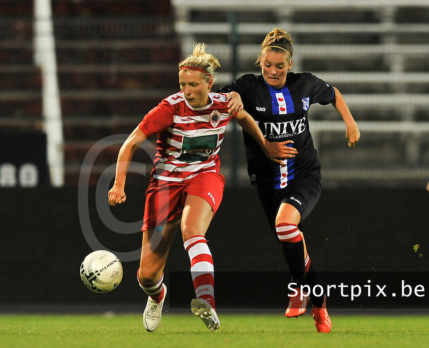 20130903 - ANTWERPEN , BELGIUM : Antwerp Sophie Mannaert  pictured protecting the ball against Heerenveen's Ingrid Schuiten during the female soccer match between Royal Antwerp FC Vrouwen and SC Heerenveen at the BOSUIL STADIUM , of the second matchday in the BENELEAGUE competition. Tuesday 3 September 2013. PHOTO DAVID CATRY