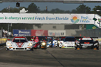 The green flag waves to start the 12 Hours of Sebring, Sebring International Raceway, Sebring, FL, March 2014.  (Photo by Brian Cleary/www.bcpix.com)
