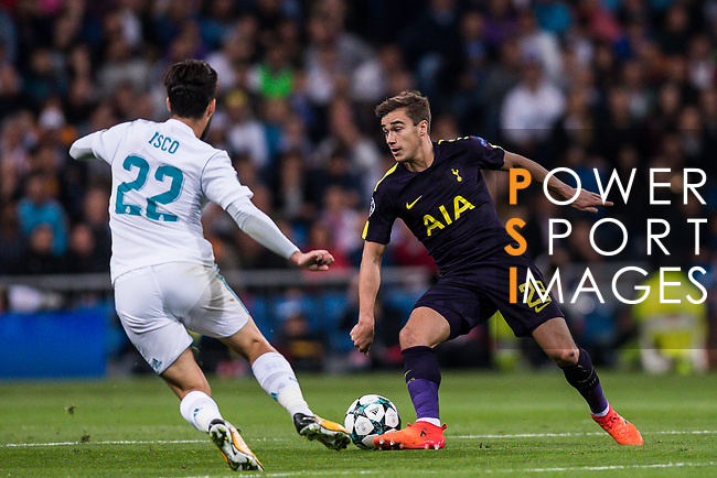 Harry Winks of Tottenham Hotspur FC (R) fights for the ball with Isco Alarcon of Real Madrid (L) during the UEFA Champions League 2017-18 match between Real Madrid and Tottenham Hotspur FC at Estadio Santiago Bernabeu on 17 October 2017 in Madrid, Spain. Photo by Diego Gonzalez / Power Sport Images