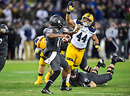 Baltimore, MD - DEC 10, 2016: Army Black Knights quarterback Ahmad Bradshaw (17) is pursued by Navy Midshipmen linebacker Micah Thomas (44) during game between Army and Navy at M&T Bank Stadium, Baltimore, MD. (Photo by Phil Peters/Media Images International)