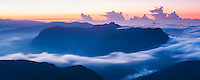 Panoramic photo of the view of mountains from the 2443m summit of Adams Peak (Sri Pada) at sunrise, Sri Lanka, Asia. This is a panoramic photo of the view of mountains from the 2443m summit of Adams Peak (Sri Pada) at sunrise, Sri Lanka, Asia. Reaching the 2443m summit of Adams Peak for sunrise requires an early start, but is worth it for the stunning, misty, panoramic view of the surrounding  mountains from the summit.