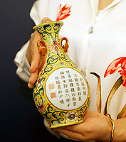 BNPS.co.uk (01202 558833)<br /> Pic: Sworders/BNPS<br /> <br /> Charity shop bargain...<br /> <br /> A Chinese vase which was bought for £1 in a charity shop could sell for £80,000 because it was made for a 18th century emperor.<br /> <br /> Unaware of its significance, the shopper listed the small yellow florally decorated vase on eBay to see if it was worth anything - only to be inundated with messages and bids.<br /> <br /> Realising the pear-shaped vase, which is designed to be attached to a wall, must be valuable, he removed it from the bidding site and took it to specialists at Sworders Fine Art Auctioneers' in Stansted Mountfitchet, Essex.<br /> <br /> The 8ins Qianlong famille rose vase, found in Hertfordshire, was made around 300 years ago in China and was marked with a symbol that meant it wasn't for export, but for the Emperor's palace.<br /> <br /> It is inscribed with an imperial poem that 'praises incense' and two iron-red seal marks that read 'Qianlong chen han' or 'the Qianlong Emperor's own mark'. It also reads 'Weijing weiyi' - 'be precise, be undivided'.