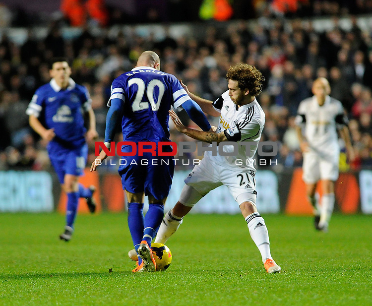 Swansea City's Jose Alberto Canas challenges Everton's Ross Barkley  -    22/12/2013 - SPORT - FOOTBALL - Liberty Stadium - Swansea - Swansea City v Everton - Barclays Premier League<br /> Foto nph / Meredith<br /> <br /> ***** OUT OF UK *****