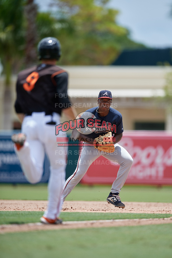 GCL Braves first baseman Mahki Backstrom (40) looks to beat Gunnar Henderson (9) to the bag during a Gulf Coast League game against the GCL Orioles on August 5, 2019 at Ed Smith Stadium in Sarasota, Florida.  GCL Orioles defeated the GCL Braves 4-3 in the second game of a doubleheader.  (Mike Janes/Four Seam Images)