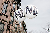 "Balloons reading ""No!"" are seen in front of houses as people take part in the March For Our Lives protest, walking from Roxbury Crossing to Boston Common, in Boston, Massachusetts, USA, on Sat., March 24, 2018, in response to recent school gun violence."