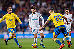 Isco Alarcon of Real Madrid (C) fights for the ball with Alberto Aquilani of UD Las Palmas (L) and Victor Machin Perez of UD Las Palmas (R) during the La Liga 2017-18 match between Real Madrid and UD Las Palmas at Estadio Santiago Bernabeu on November 05 2017 in Madrid, Spain. Photo by Diego Gonzalez / Power Sport Images
