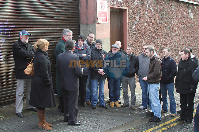 Sinn Fein President Gerry Adams meets people in Drogheda with Arthur Morgan after announcing he is to seek his party's nomination in the Louth constituency for the next general election...(Photo credit should read Jenny Matthews www.newsfile.ie)....This Picture has been sent you under the condtions enclosed by:.Newsfile Ltd..The Studio,.Millmount Abbey,.Drogheda,.Co Meath..Ireland..Tel: +353(0)41-9871240.Fax: +353(0)41-9871260.GSM: +353(0)86-2500958.email: pictures@newsfile.ie.www.newsfile.ie.