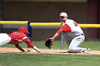 Lowell Spinners first baseman Sam Travis (40) picks a throw in the dirt as Ryan Aper (3) dives back to first during a game against the Batavia Muckdogs on July 17, 2014 at Dwyer Stadium in Batavia, New York.  Batavia defeated Lowell 4-3.  (Mike Janes/Four Seam Images)