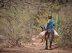 A boy rides a donkey to a weekly market in Gidel, a village in the Nuba Mountains of Sudan.