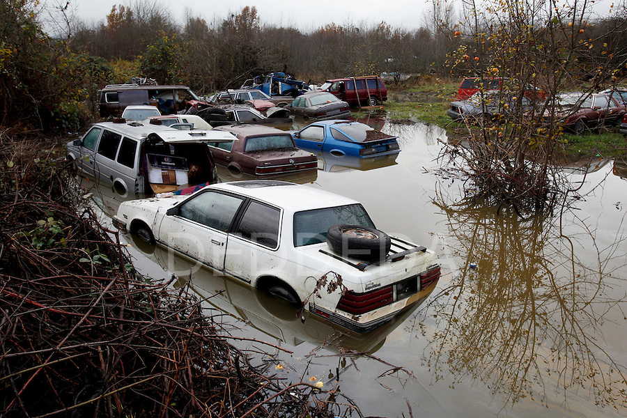 Old cars sit in a flooded yard at the corner of Samuel Road and Tzouhalem Road near Cowichan Bay, on the Cowichan First Nation Reserve, the day after a state of emergency was called due to flooding, in Duncan, BC, British Columbia, Canada. Photo assignment for the Canadian Press (CP).