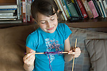 Berkeley CA Girl, six-years-old proudly displaying the first knitted row she's ever done MR