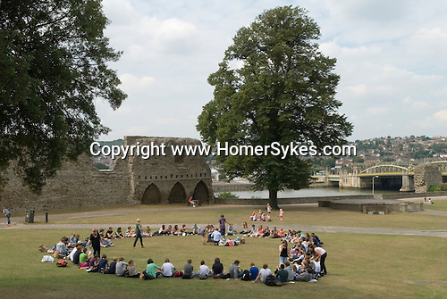 Rocherster Kent Uk. Rochester Castle Keep, a school party of children on a day out. River Medway and bridge crossing to Strood to the north.