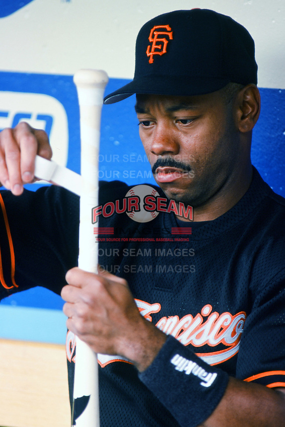 Ellis Burks of the San Francisco Giants tapes his bat before a 1999 Major League Baseball season game against the Los Angeles Dodgers at Dodger Stadium in Los Angeles, California. (Larry Goren/Four Seam Images)