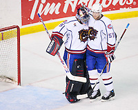 April 28, 2007; Hamilton, ON, CAN; Hamilton Bulldogs goalie (29) Carey Price and defenceman (55) Andrew Archer celebrate their 6-2 win over the Rochester Americans in game six of the AHL north division semifinal at Copps Coliseum. With the win the Bulldogs eliminated the Americans from the playoffs. Mandatory Credit: Ron Scheffler, Special to the Spectator. (File number RRSA8581).