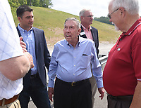NWA Democrat-Gazette/FLIP PUTTHOFF <br />Former Arkansas highway commissioner Bobby Hopper (center) visits Wednesday May 10 2017 during the ribbon cutting ceremony for the Bella Vista bypass.