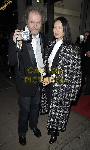 LONDON, ENGLAND - NOVEMBER 27: Mike Figgis &amp; Rosey Chan attend the &quot;Mikhail Baryshnikov: Dancing Away&quot; photography collection private view, Contini Art UK, New Bond St., on Thursday November 27, 2014 in London, England, UK. <br /> CAP/CAN<br /> &copy;Can Nguyen/Capital Pictures