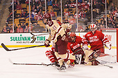 Graham McPhee (BC - 27), Dante Fabbro (BU - 17), Colin White (BC - 18), Jake Oettinger (BU - 29) - The Boston University Terriers defeated the Boston College Eagles 3-1 in their opening Beanpot game on Monday, February 6, 2017, at TD Garden in Boston, Massachusetts.