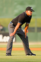 Umpire Roberto Ortiz handles the calls on the bases during the South Atlantic League game between the Delmarva Shorebirds and the Kannapolis Intimidators at Fieldcrest Cannon Stadium on May 21, 2011 in Kannapolis, North Carolina.   Photo by Brian Westerholt / Four Seam Images