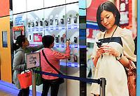 A customer look at a range of mobile phones in Hong Kong..