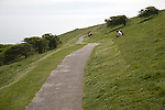 Tarmac footpath crossing chalk downs near Bournemouth,  East Sussex, England