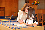 A Bat Mitzvah girl and her mom share a quiet moment on the before her service.