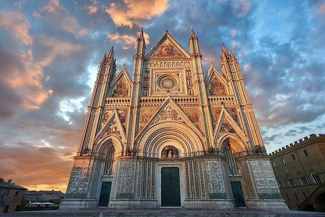 Sunset picture of the 14th century Tuscan Gothic style facade of the Cathedral of Orvieto, designed by Maitani, Umbria, Italy