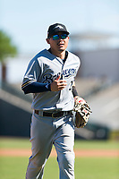 Peoria Javelinas second baseman Keston Hiura (23), of the Milwaukee Brewers organization, jogs off the field between innings of an Arizona Fall League game against the Surprise Saguaros at Surprise Stadium on October 17, 2018 in Surprise, Arizona. (Zachary Lucy/Four Seam Images)