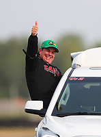 Aug 18, 2018; Brainerd, MN, USA; NHRA top fuel driver Billy Torrence celebrates after qualifying number one for the first time in his career during qualifying for the Lucas Oil Nationals at Brainerd International Raceway. Mandatory Credit: Mark J. Rebilas-USA TODAY Sports