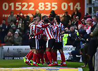 Lincoln City's Lee Frecklington celebrates scoring his sides equalising goal to make the score 1-1 with team-mates<br /> <br /> Photographer Chris Vaughan/CameraSport<br /> <br /> The EFL Sky Bet League Two - Lincoln City v Notts County - Saturday 13th January 2018 - Sincil Bank - Lincoln<br /> <br /> World Copyright &copy; 2018 CameraSport. All rights reserved. 43 Linden Ave. Countesthorpe. Leicester. England. LE8 5PG - Tel: +44 (0) 116 277 4147 - admin@camerasport.com - www.camerasport.com