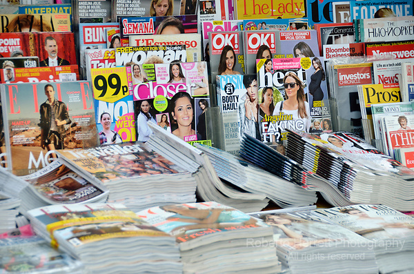 Popular magazines on a newsstand.