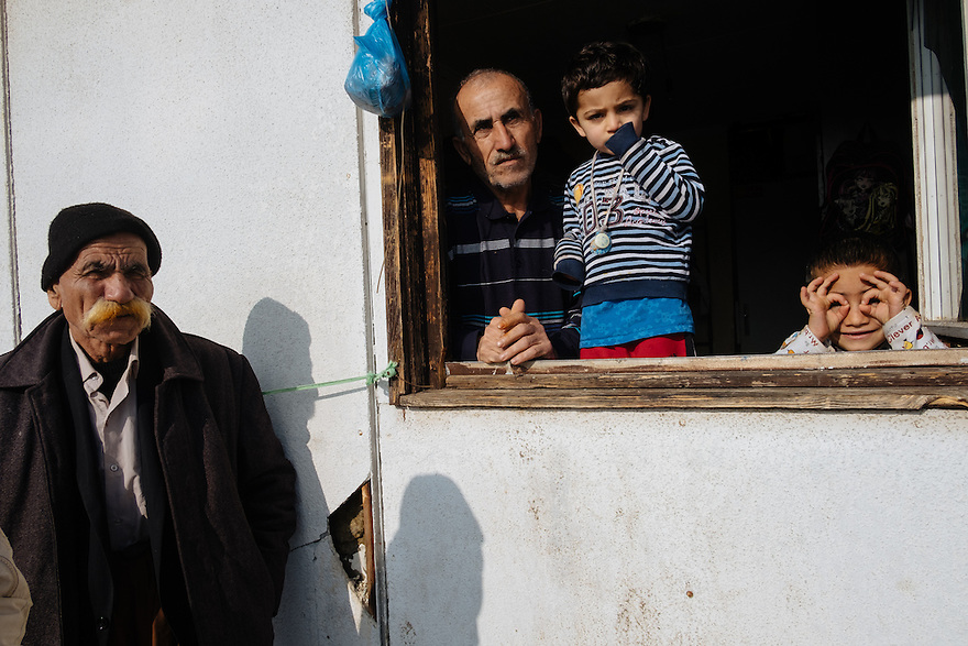 Belgrade, Serbia-- Jan. 26, 2017-- Rekesh, a Yazidi father from Iraq with his three sons at Refugee Centre Krnjaca, left, another Yazidi man, Ismael, which provides shelter for 1200 of asylum-seekers, primarily families. More than half are children.