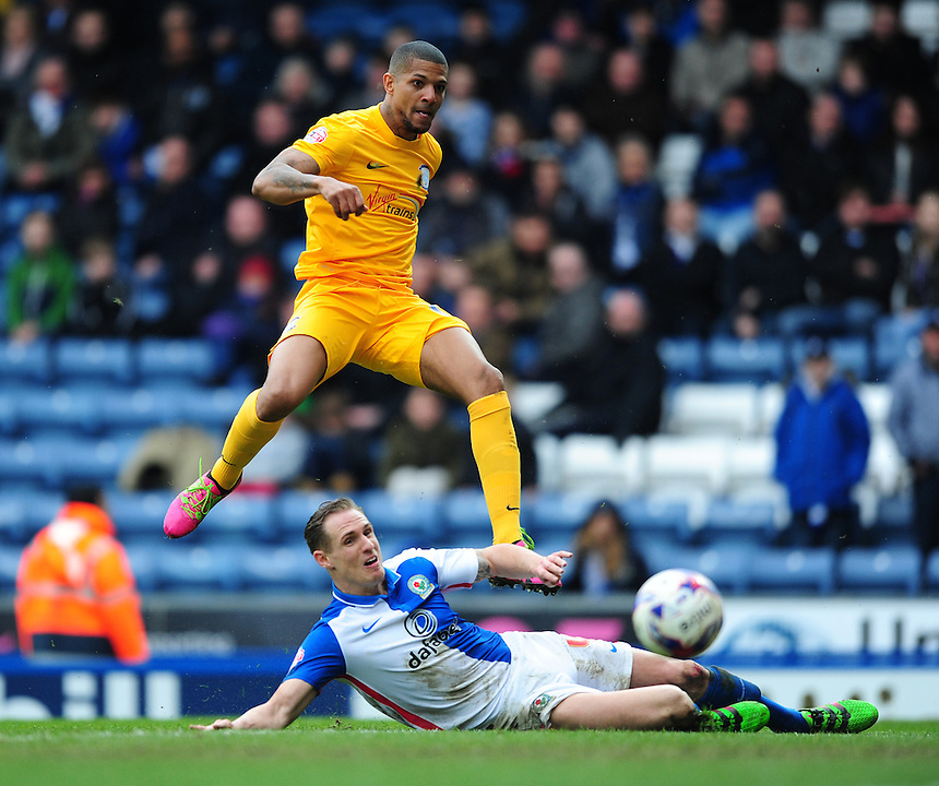 Preston North End's Jermaine Beckford hits a shot past Blackburn Rovers' Matthew Kilgallon which went just wide of the post<br /> <br /> Photographer Chris Vaughan/CameraSport<br /> <br /> Football - The Football League Sky Bet Championship - Blackburn Rovers v Preston North End - Saturday 2nd April 2016 - Ewood Park - Blackburn<br /> <br /> &copy; CameraSport - 43 Linden Ave. Countesthorpe. Leicester. England. LE8 5PG - Tel: +44 (0) 116 277 4147 - admin@camerasport.com - www.camerasport.com