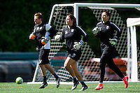 Seattle, WA - Sunday, April 17, 2016: Seattle Reign FC goalkeepers Haley Kopmeyer (28) and Hope Solo (1) warm-up with Seattle Reign FC goalkeeper Coach, Ben Dragavon at Memorial Stadium. Sky Blue FC defeated the Seattle Reign FC 2-1 during a National Women's Soccer League (NWSL) match at Memorial Stadium.