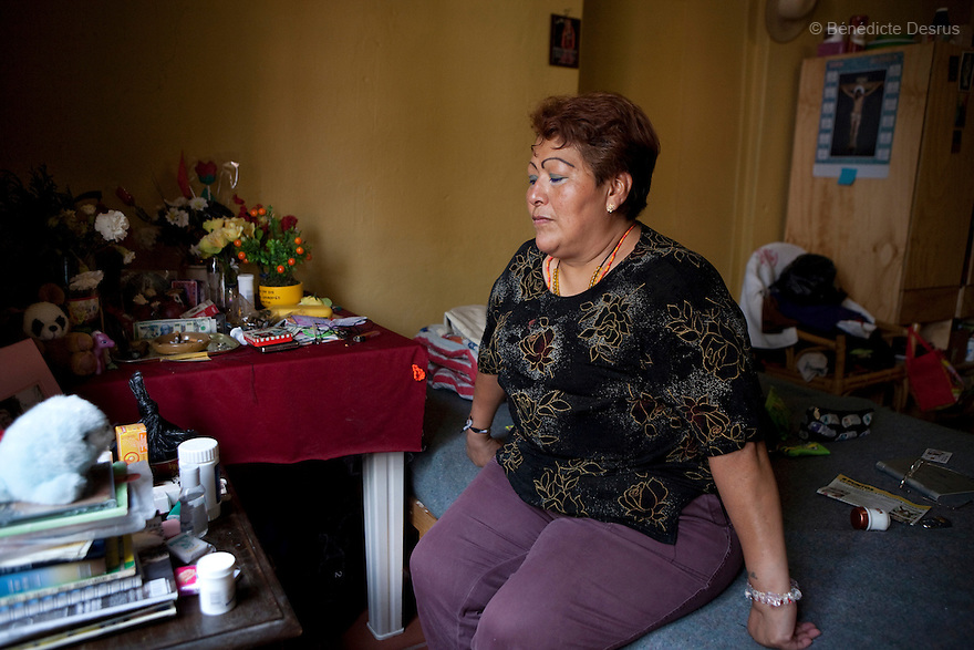 Paola, a resident of Casa Xochiquetzal, portrayed in her bedroom before going to work on the streets of Mexico City, Mexico on May 24, 2009. Casa Xochiquetzal is a shelter for elderly sex workers in Mexico City. It gives the women refuge, food, health services, a space to learn about their human rights and courses to help them rediscover their self-confidence and deal with traumatic aspects of their lives. Casa Xochiquetzal provides a space to age with dignity for a group of vulnerable women who are often invisible to society at large. It is the only such shelter existing in Latin America. Photo by Bénédicte Desrus