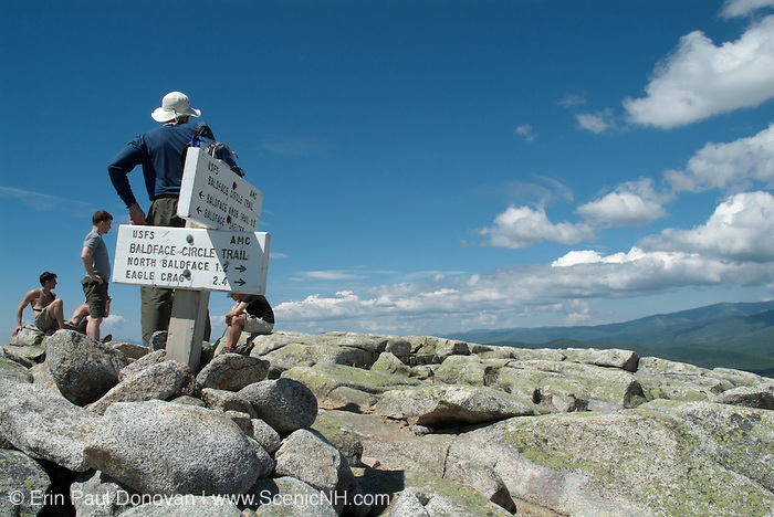 Hikers relax on the summit of South Baldface Mountain in the scenic landscape of the White Mountains, New Hampshire USA during the spring months. .Notes:\