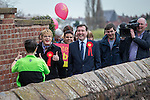 © Joel Goodman - 07973 332324 . 17/04/2015 . Chester , UK . A woman jogging along the city walls gives Eddie Izzard a thumbs up as Izzard and Chris Matheson campaign in the City of Chester constituency for the Labour Party . Photo credit : Joel Goodman