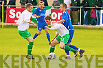 Killarney Athletic's Rory O'Sullivan and Killarney Celtic's l-r: Gary Keane and Celtic's Chris Brady.