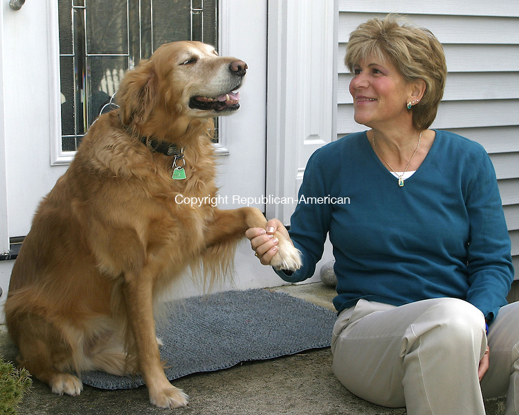 CHESHIRE, CT -08 JANUARY 2007 -010808DA03- Gina Reynolds sits with her dog Sandy in the front of her Cheshire home Tuesday. Reynolds had major brain surgery to terminate seizure that are a symptom of her epilepsy.<br /> Darlene Douty/Republican-American