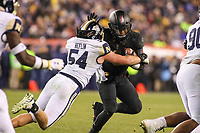Philadelphia, PA - December 8, 2018:  Navy Midshipmen linebacker Taylor Heflin (54) tackles Army Black Knights quarterback Kelvin Hopkins Jr. (8) during the 119th game between Army vs Navy at Lincoln Financial Field in Philadelphia, PA. (Photo by Elliott Brown/Media Images International)