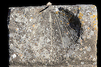 Sundial in the Forum or marketplace of Volubilis, Northern Morocco. Volubilis was founded in the 3rd century BC by the Phoenicians and was a Roman settlement from the 1st century AD. Volubilis was a thriving Roman olive growing town until 280 AD and was settled until the 11th century. The buildings were largely destroyed by an earthquake in the 18th century and have since been excavated and partly restored. Volubilis was listed as a UNESCO World Heritage Site in 1997. Picture by Manuel Cohen